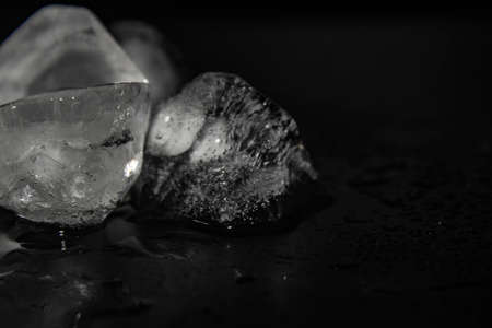 Natural ice cubes on black background, isolated on black. Included clipping path for each piece.pieces of ice on a black background, ice, cold Stock Photo
