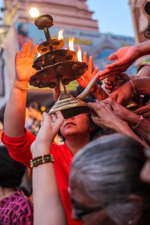 Rishikesh, India - March, 23, 2015. Ganga Aarti ceremony in Parmarth Niketan ashram at sunset. Rishikesh is World Capital of Yoga, has numerous yoga centers