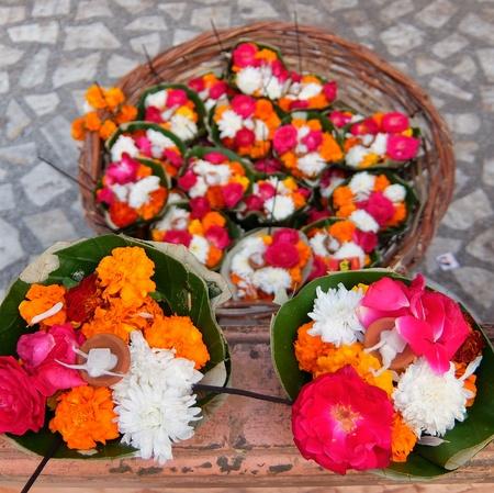 Flowers for Ganga Aarti ceremony in Parmarth Niketan ashram at sunset. Rishikesh is World Capital of Yoga, has numerous yoga centers