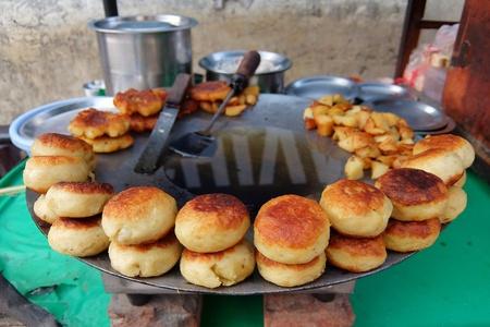 Rishikesh, India - November, 9th, 2017. Aloo tikki (fried potato cutlets), famous indian street food. Stock Photo