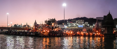 Haridwar, India - December, 11th, 2016. People on the Ganga river embankment, Har Ki Pauri. Har Ki Pauri is a famous ghat on the banks of the Ganges in Haridwar. Editorial