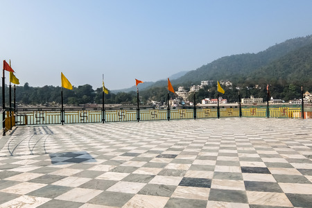 Rishikesh, India - December, 06th, 2016. Ganga river embankment in Ram Jhula, Rishikesh