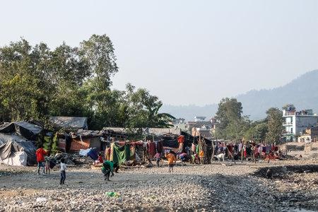 Rishikesh, India - December, 07th, 2016. Poor children playing in slums near Rishikesh Editorial