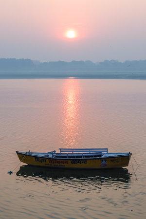 Varanasi, India - December, 9th, 2017. Boats on the ghats of Varanasi. Editorial