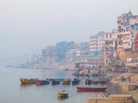 Varanasi, India - December, 9th, 2017. Boats on the ghats of Varanasi. Redakční
