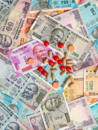 Pills over the 10, 20, 50, 100, 200, 500 and 2000 Indian rupees, old and new notes.