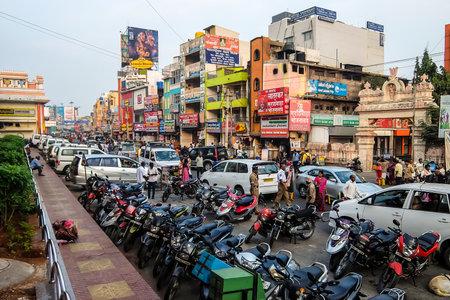 Tirupati, India - Circa January, 2018. Road traffic near the railway station in Tirupati. Редакционное