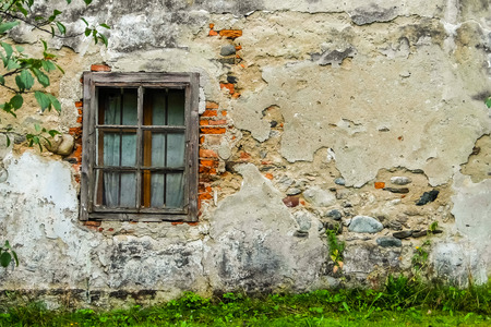 View of an old shabby stone wall with window Stockfoto
