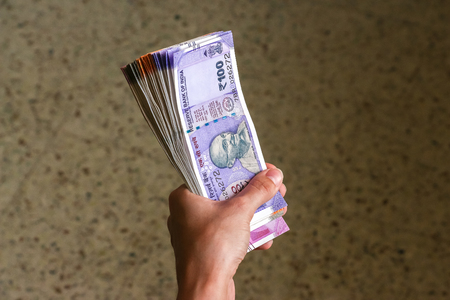 Womans hands holding brand new indian 100, 200, 500, 2000 rupees banknotes. Stok Fotoğraf