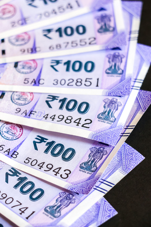 Close up view of brand new indian one hundred rupees banknotes.