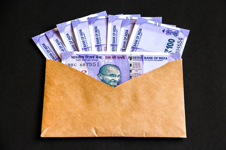 Close up view of envelope with brand new indian one hundred rupees banknotes. Stock Photo