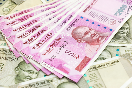 close up view of brand new 2000 indian rupees banknotes over 500 rupees banknotes background. Stok Fotoğraf