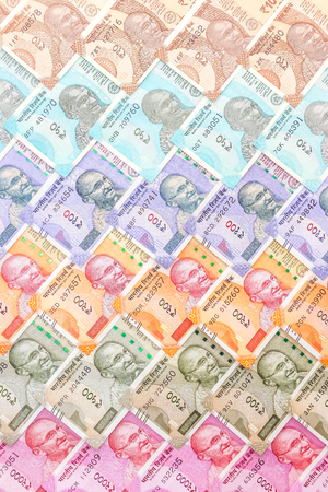Close up view of brand new indian 10, 50, 100, 200, 500 and 2000 rupees banknotes. Colorful cash money pattern background.