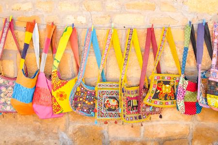 Jaisalmer, India - Circa March, 2018. Beautiful bags for sale at the street shop. Standard-Bild