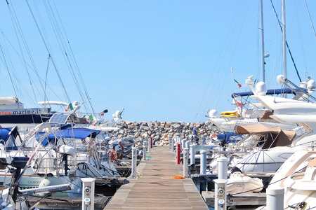 San Vincenzo, Italy - Circa  September 2017. Sunny day in harbor. View of yachts moored in a small coastal town on the shores of the Thyrranean sea, is one of the best place of the Etruscan Coast. Editorial
