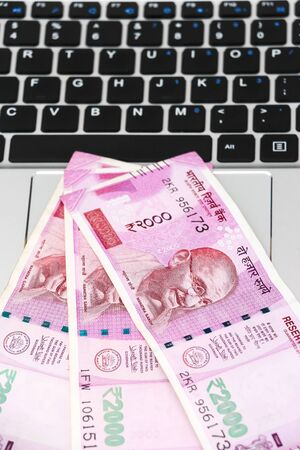 Close up view of brand new indian 2000 rupees banknotes and  laptop. Stok Fotoğraf