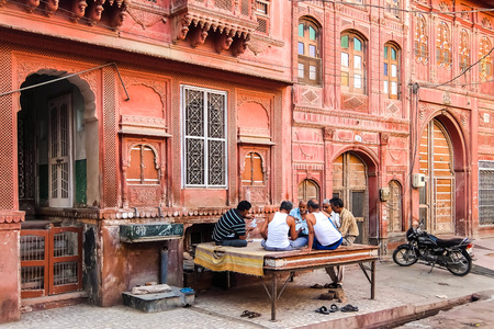 Bikaner, India - Circa March 2018. Men playing cards on the streets of Bikaner.