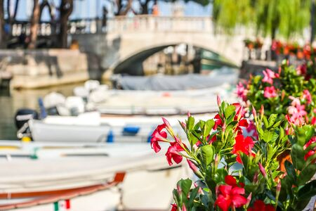 Sunny day in small town Desenzano, located on Garda lake. 写真素材