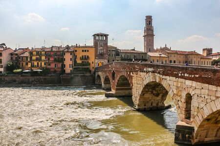 Verona, Italy - Circa September 2018. View of Ponte Pietra bridge in sunny day. 写真素材