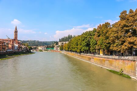 Verona, Italy - Circa September 2018. View of Adige river embankment in sunny day. 写真素材