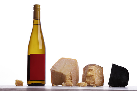 A bottle of white wine, expensive cheese, musty cheese, black cheese. On white background. Place for logo. Stock Photo
