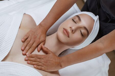 Beautiful young woman relaxing with hand massage Banque d'images