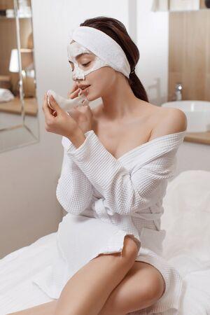 Facial Mask. Woman Applying Cosmetic Alginate Mask