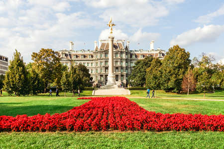 eisenhower: The Eisenhower Executive Office Building and First Division Memorial column with flower lawn in front on a bright and sunny fall day. Editorial