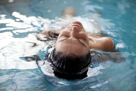woman relaxing: Young woman relaxing in the water Stock Photo