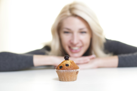 Woman about to eat cake Stock Photo