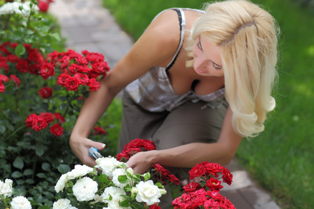 woodfire: Happy lady working in the garden. Stock Photo