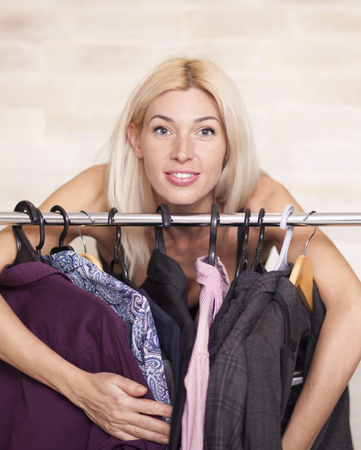 3 persons only: Woman looking at clothing on rail