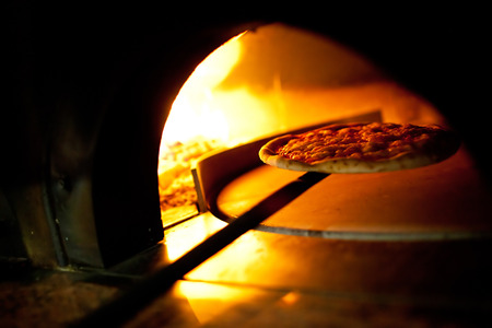 woodfire: A pizza in a oven burning