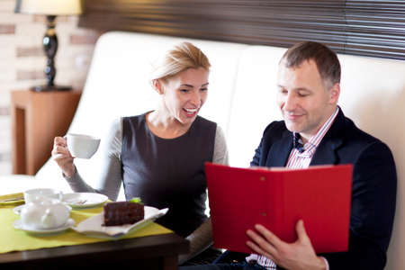 dining out: happy couple dining out in restaurant and reading menu Stock Photo
