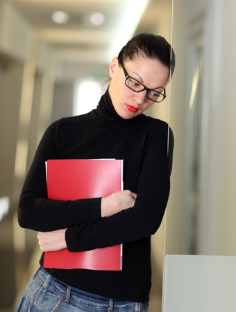 Tired secretary with a lot of documents Stock Photo