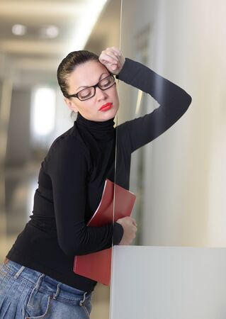 dossier: Tired secretary with a lot of documents Stock Photo