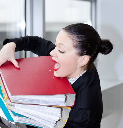 overloading: Tired secretary with a lot of documents Stock Photo
