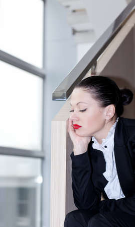 embarrassment: Downsizing, sad business young beatiful woman in office