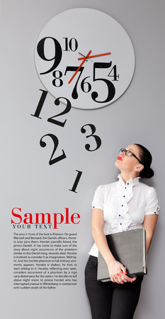 Beatiful Business Woman under the clock. Concept Stock Photo