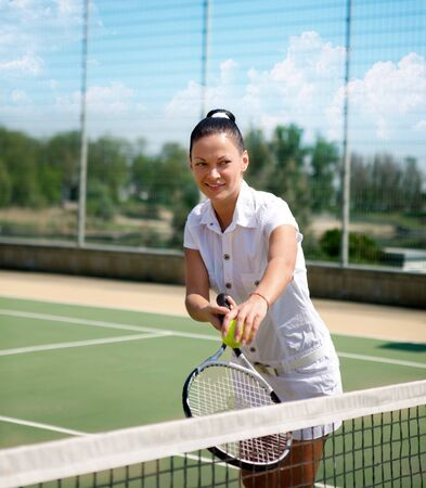 beatiful: Young beatiful woman on a tennis court Stock Photo