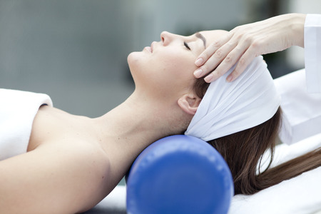 Save Download Preview Young beatiful Woman receiving healty spa treatment