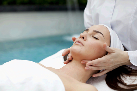 Young beatiful Woman receiving healty spa treatment