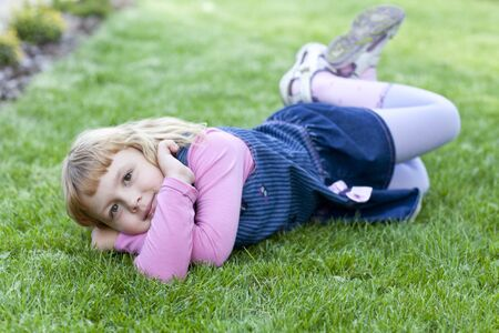 girl lying on the lawn in the summer
