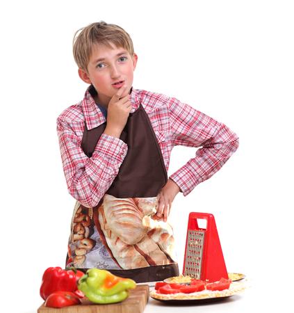 Boy rub vegetables in the white background Standard-Bild