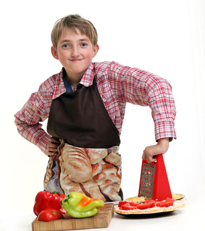 Boy rub vegetables in the white background Stock Photo
