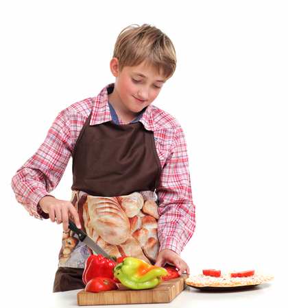 Boy rub vegetables in the white background Imagens