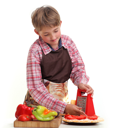 Boy rub vegetables in the white background Standard-Bild