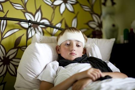 sickbed: Sick boy lying in bed