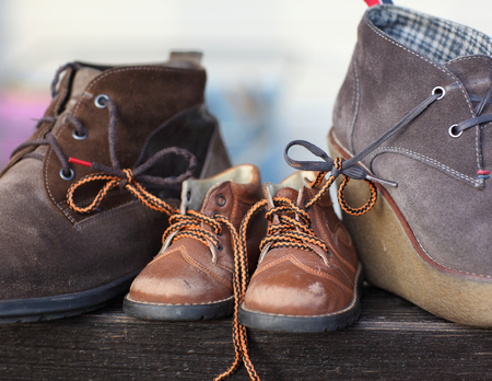 tied together: Shoes tied together mom and dads son. The symbol of family love