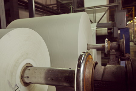 shafts: Spools of paper .Working print machine. selective focus on metal shafts and screws